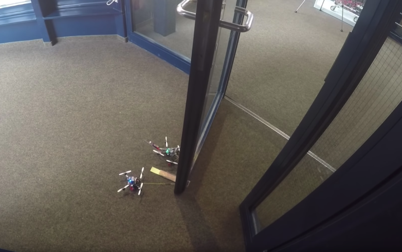 Tiny drones can open doors to 40 times heavier than them