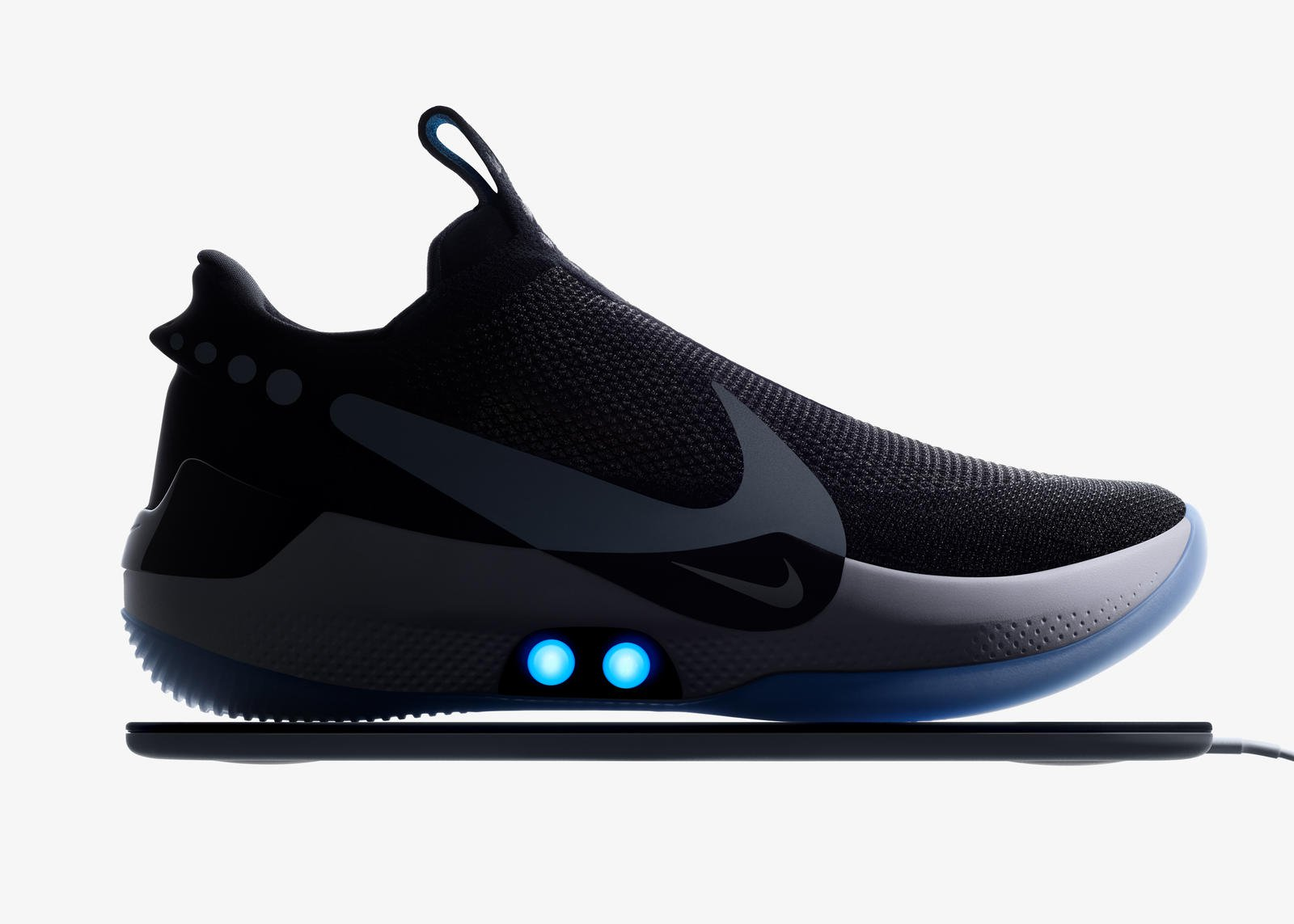 Presents sneakers with an automatic lacing. Yes, they need to charge