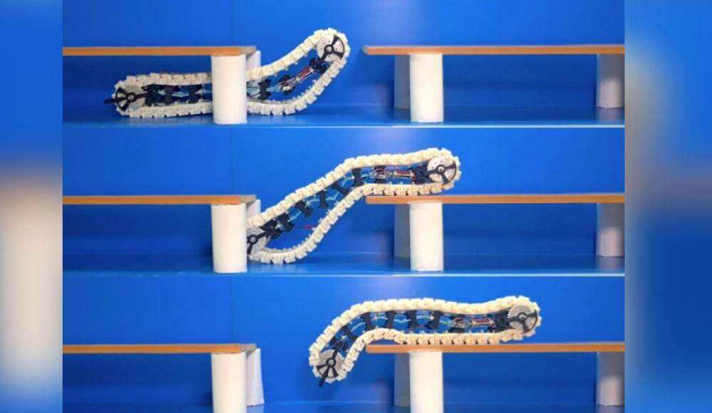 Watch as the robot-caterpillar jumps over obstacles